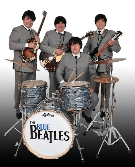 The Blue Beatles Band Standing With Instruments